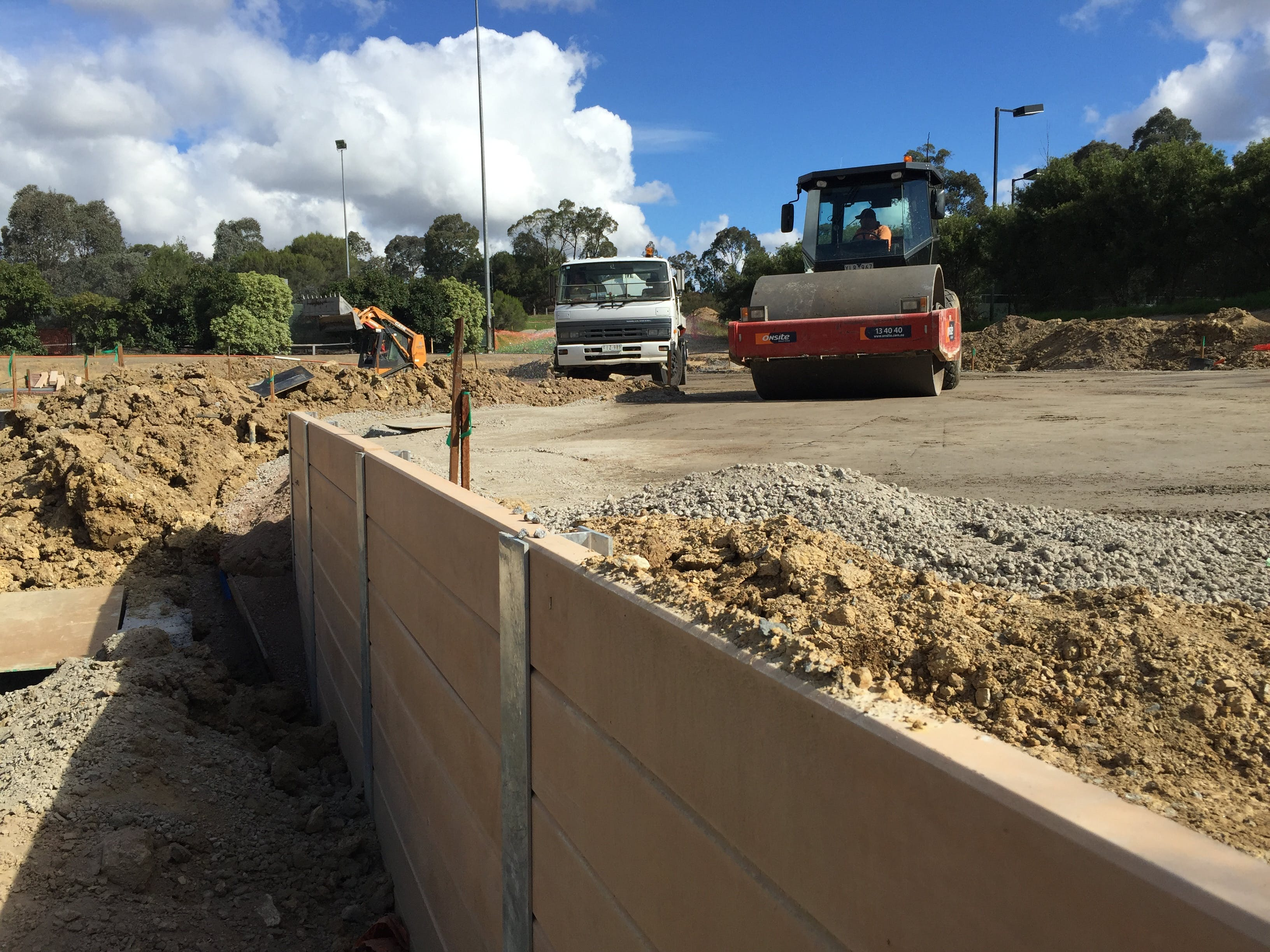 The new car park between the tennis courts and bowling green is taking shape with the construction of retaining walls.