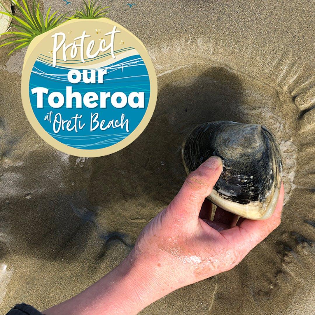 Toheroa in hand on Oreti Beach