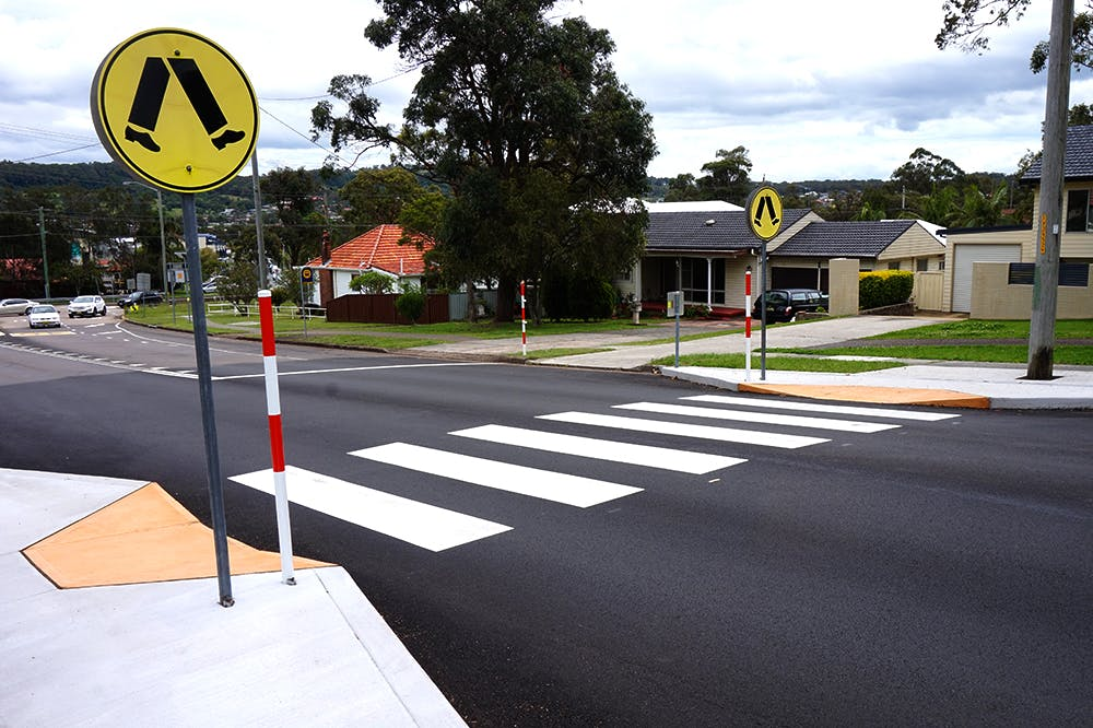 Marked Pedestrian crossing at street level (also known as Zebra Crossing)