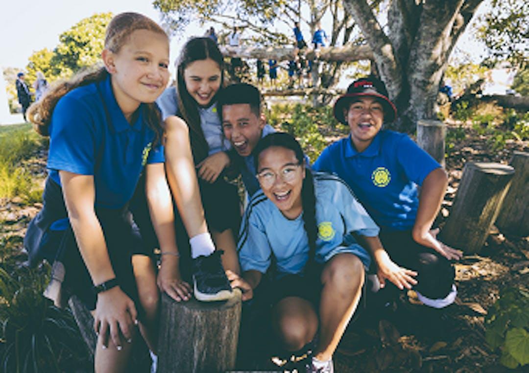 Local schoolchildren smile at the camera
