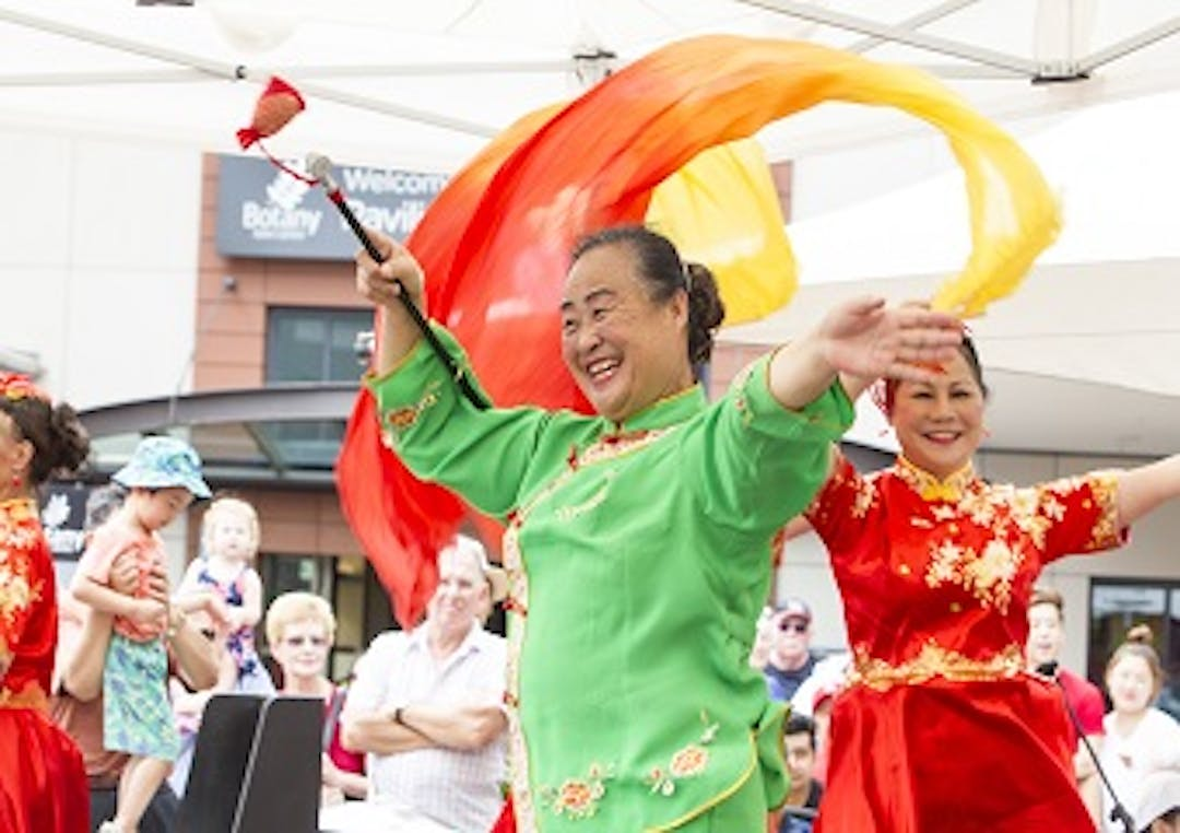 Two women perform a cultural dance at Chinese New Year celebrations at Botany Town Centre.