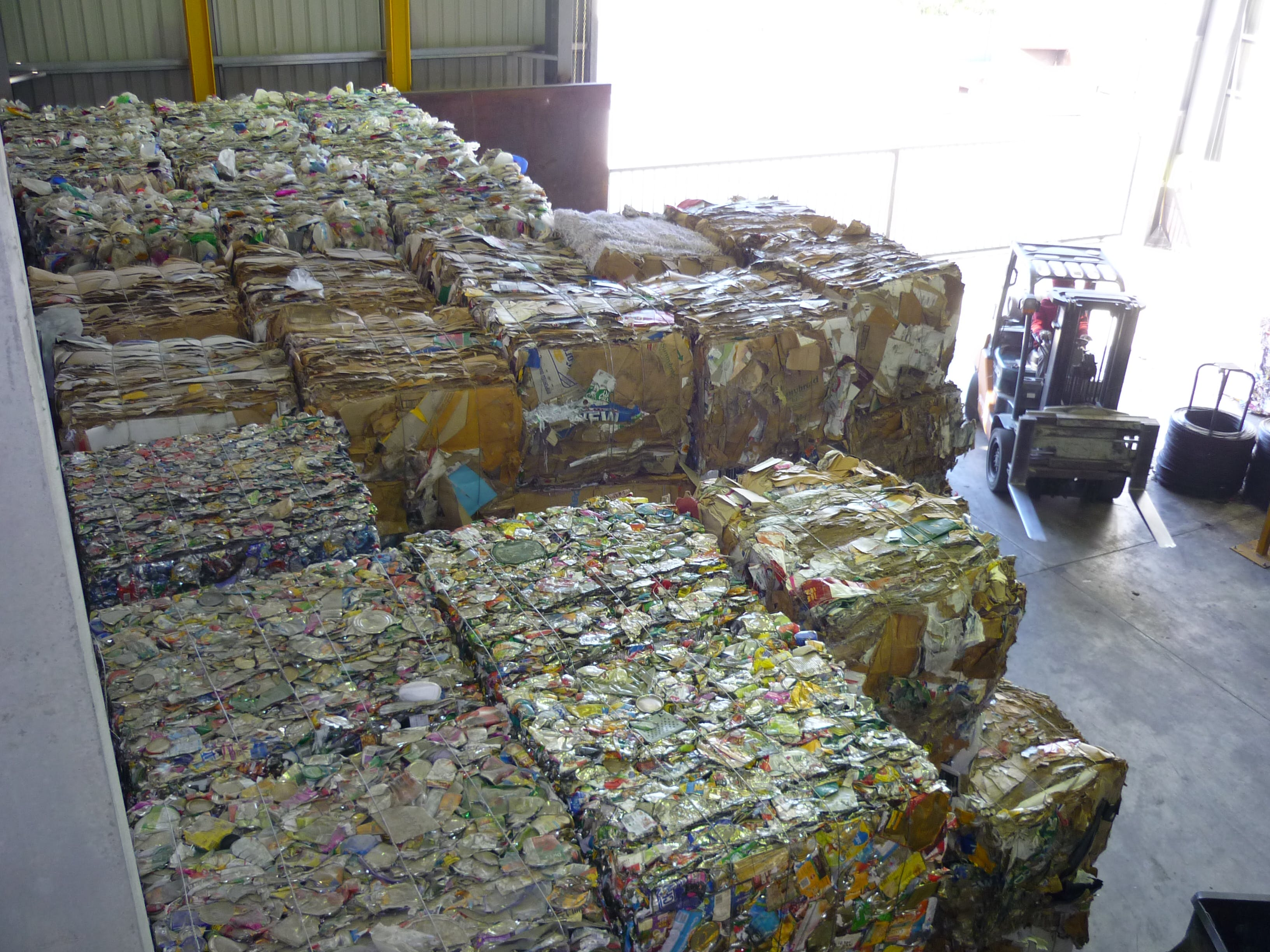 Materials Recovery Facility - Cardboard, plastic and metal cans cubed and ready for transport