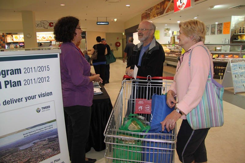 Council's Communications Officer - Media, Fran Silk (left), discusses the Delivery Program and Operational Plan with Bob and Noelene Harris of Tomewin during the information stall at Murwillumbah's Sunnyside Shopping Centre.