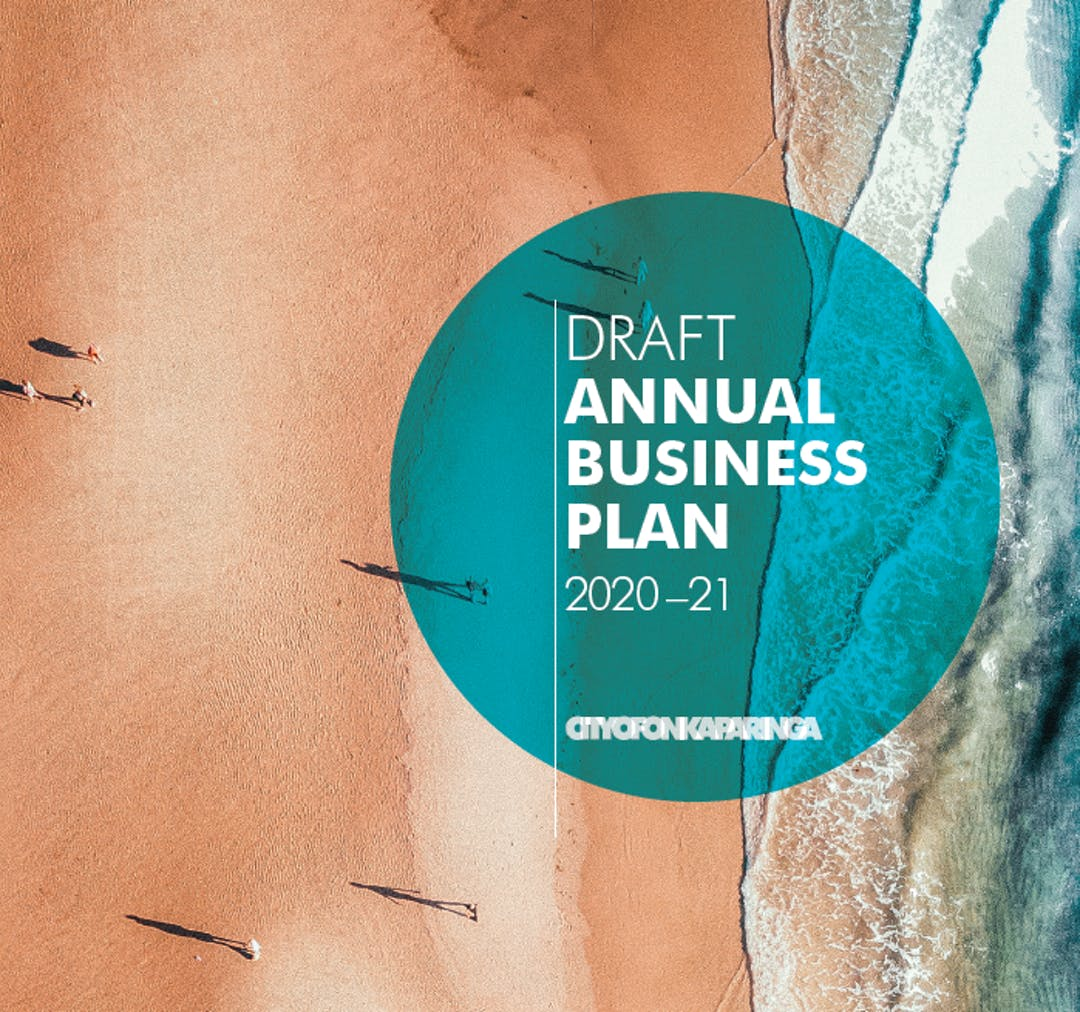 Cover image from the draft Annual Business Plan for 2020-21 showing an aerial photo of people walking along the beach casting long shadows.