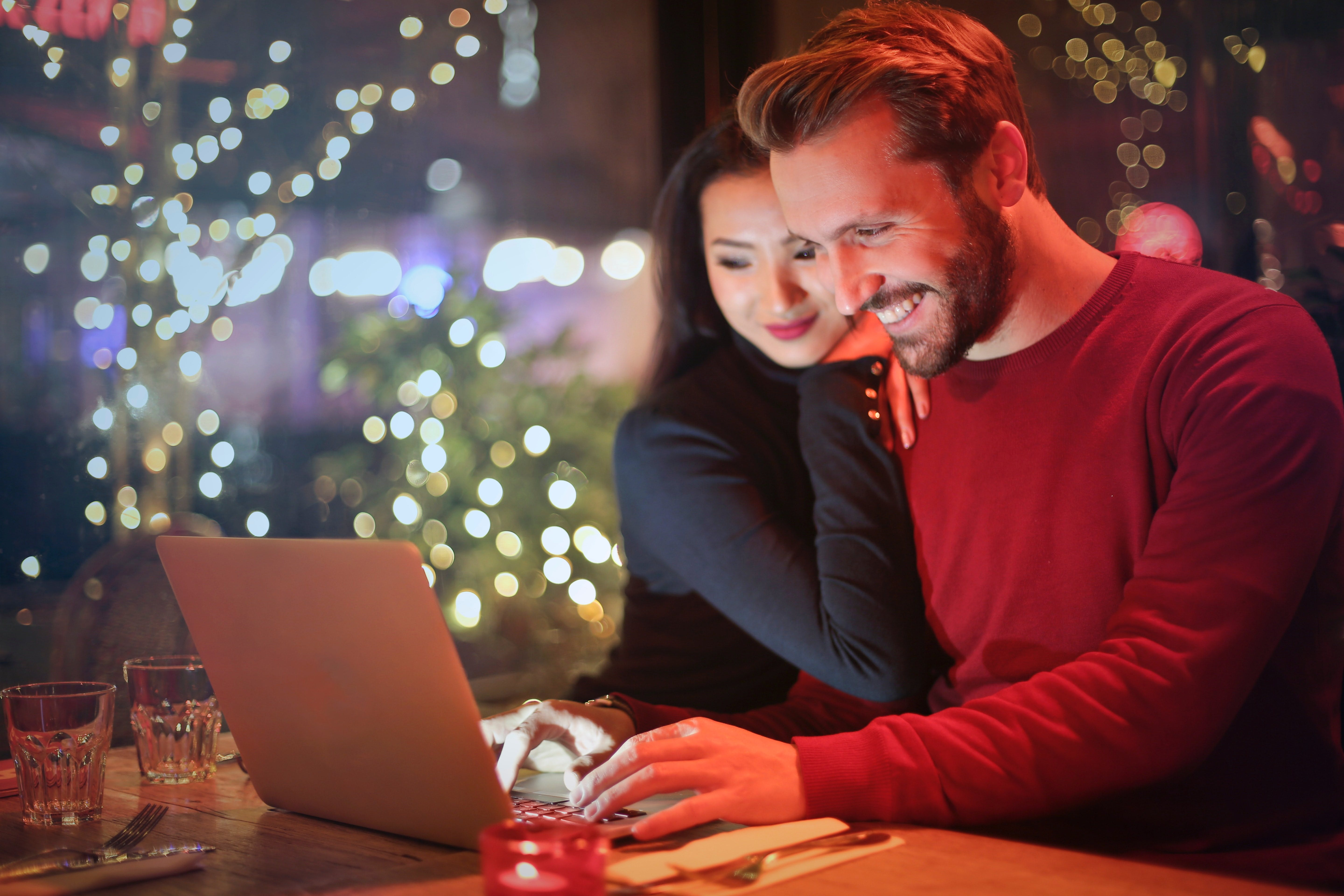 Couple sits at computer together in the evening.jpg