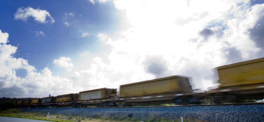 Freight train travelling across landscape