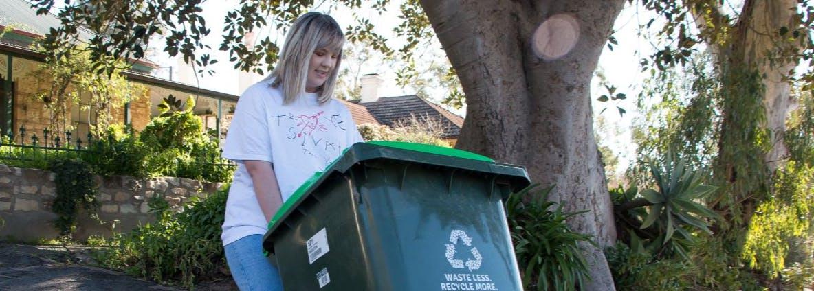 woman disposing of green waste