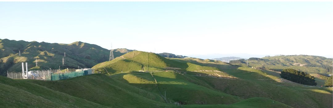 Green hills and skyline showing grazing land.