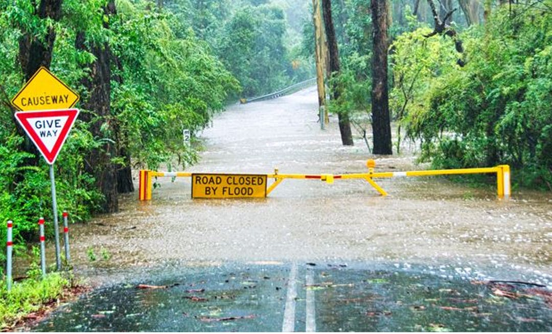 Floodwater over road