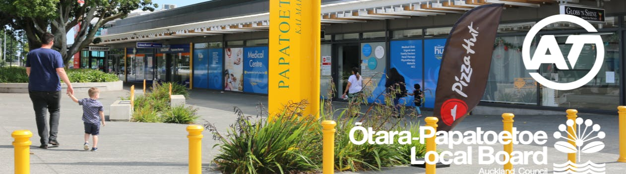 A father holding a small boy's hand as they walk through the revitalised Papatoetoe Mall.