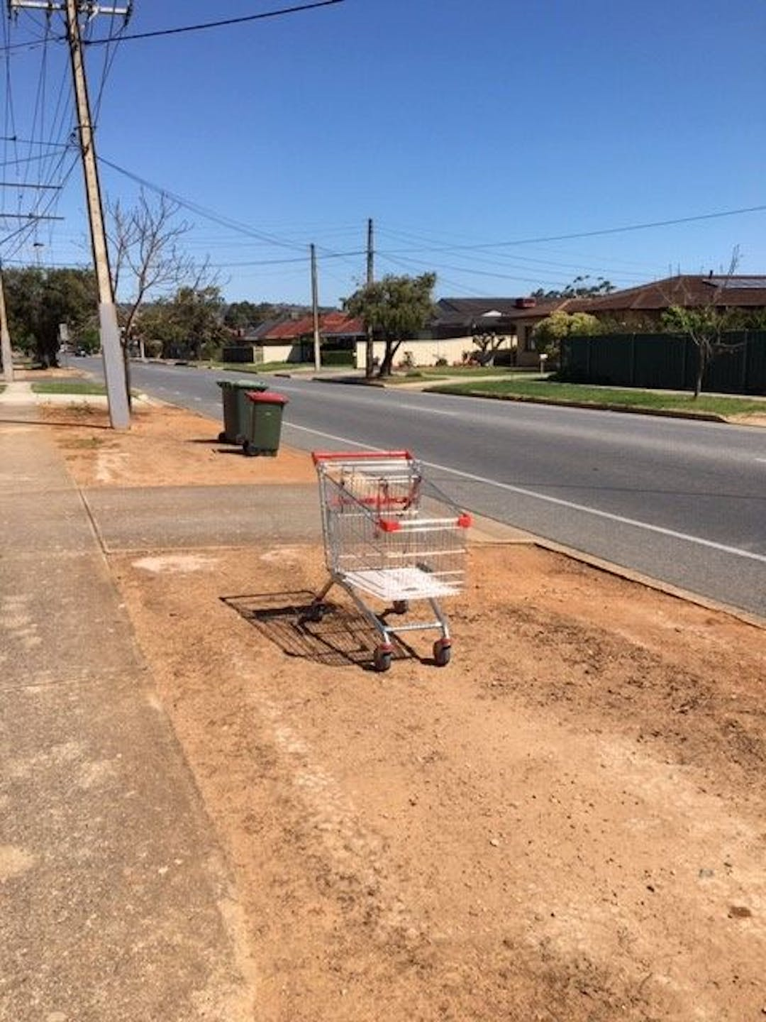 Photo of a shopping trolley sadly abandoned on a street in Marion