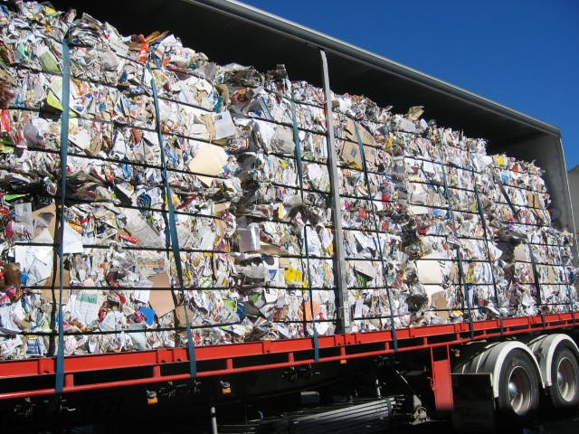Mrf And Trucks Baled Paper To Be Transported