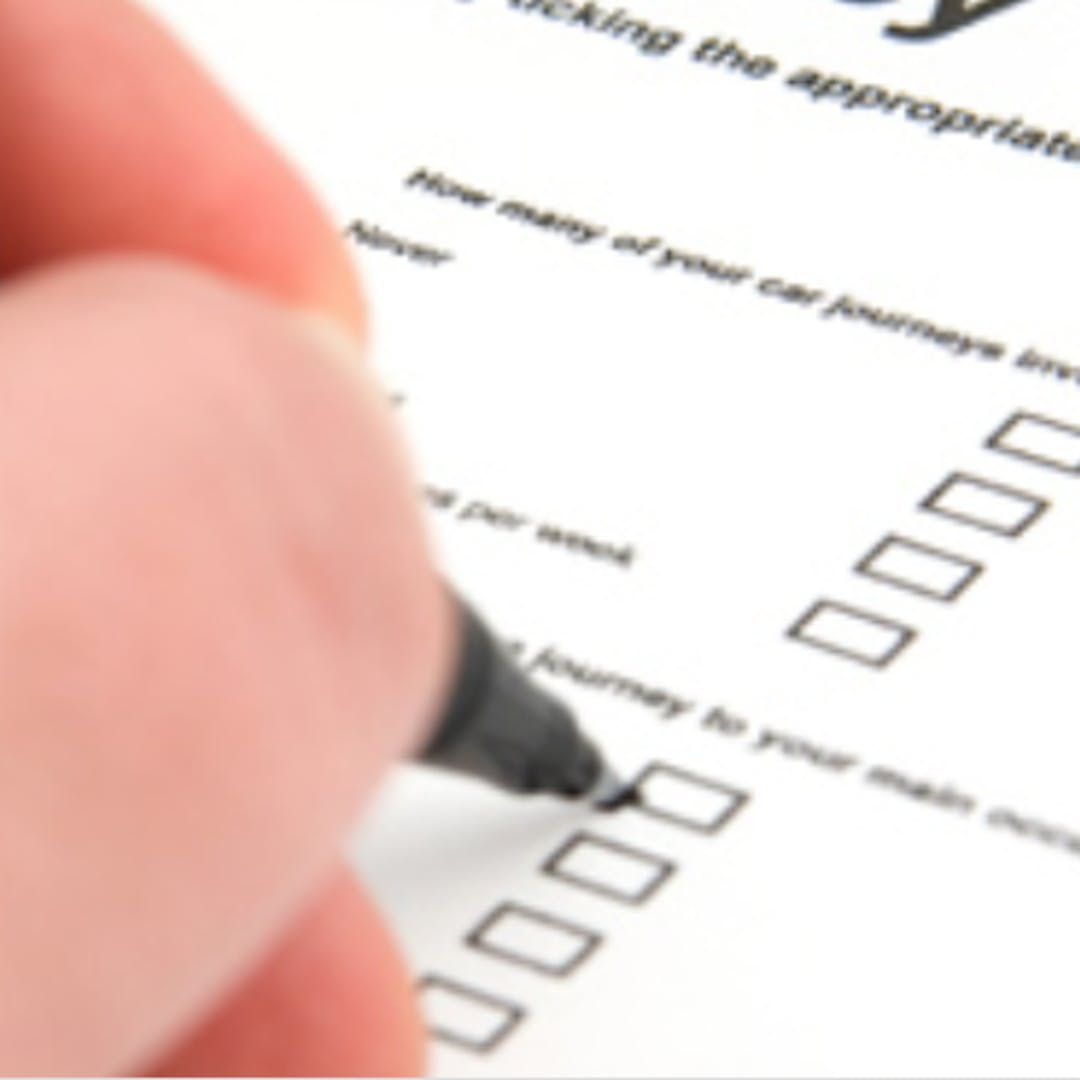 person filling out a registration form