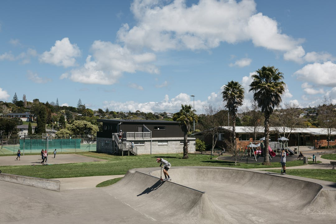 A skate parks with children using scooters