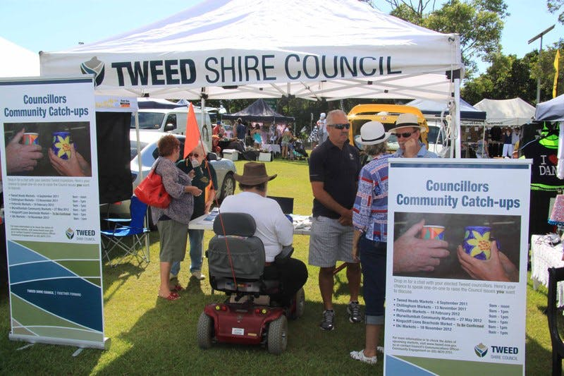 Councillor Dot Holdom and General Manager Mike Rayner talk to visitors to Council's Councillors' Community Catch-up stall at the Pottsville Beach Markets.