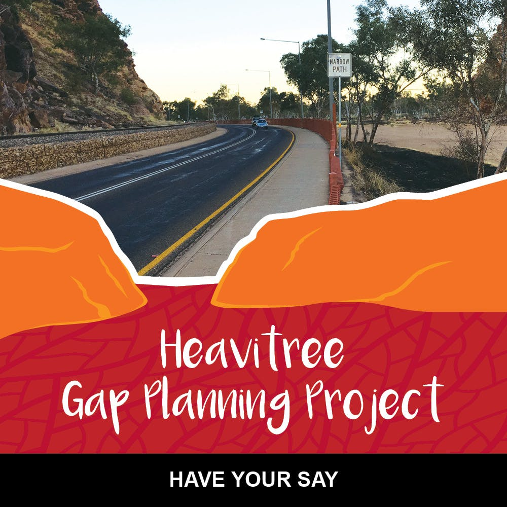 Image of the existing transport infrastructure of Stuart Highway through Heavitree Gap showing road, railway and narrow footpath.