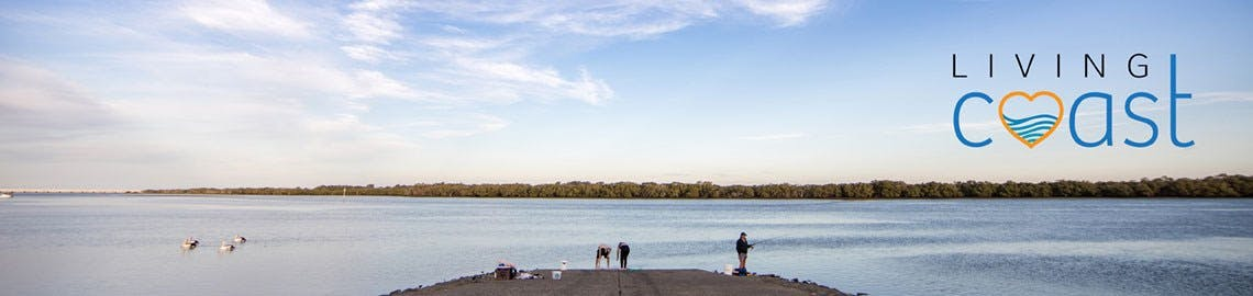An image of people fishing in Pumicestone Passage with the Moreton Bay Living Coast project logo