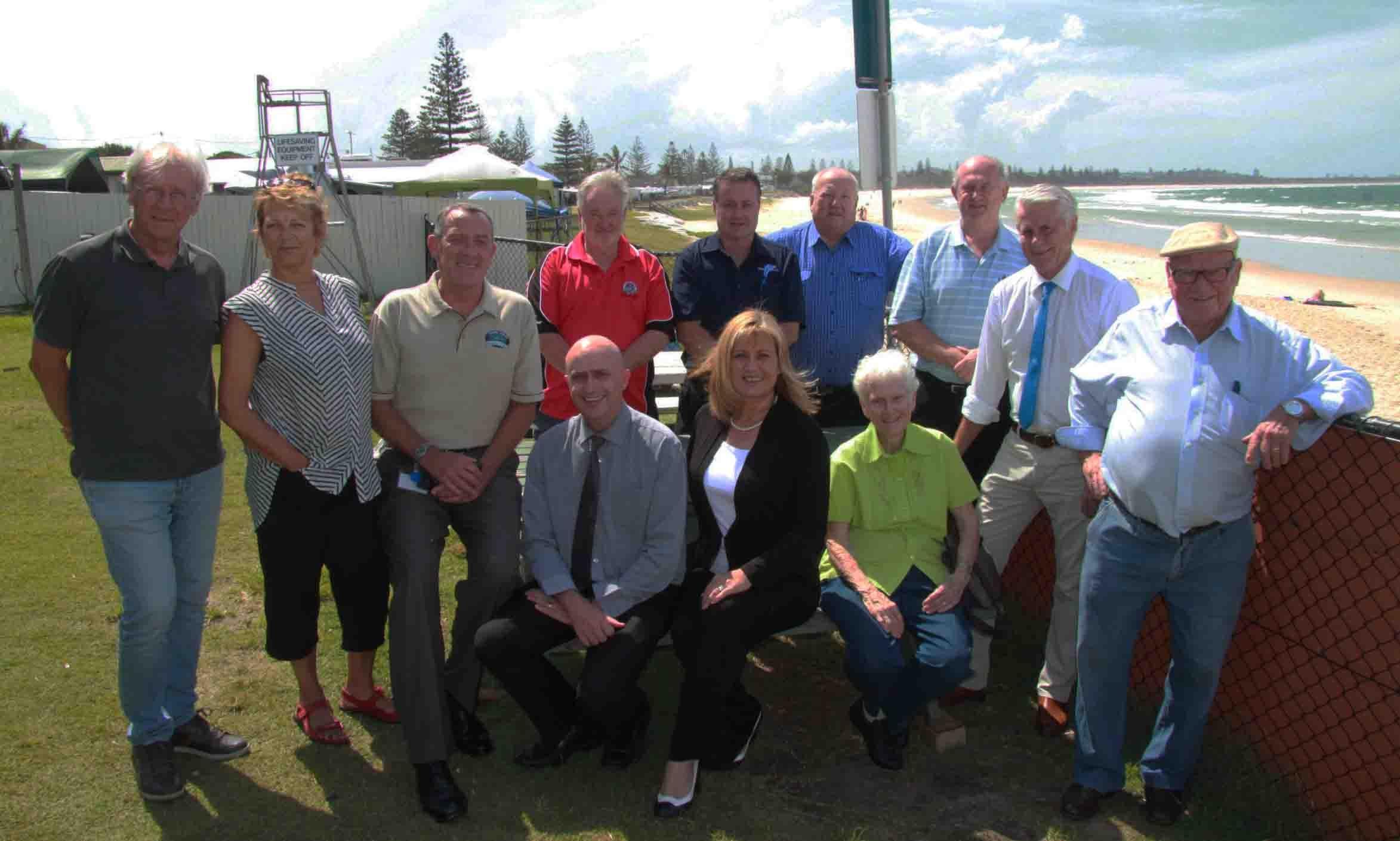 Council leaders, State and Federal Members, chamber delegates, resident association members, Tweed Coast Holiday Park representatives, Kingscliff Beach Bowls Club management and Cudgen Headland Surf Club delegates gather to celebrate the Federal funding.