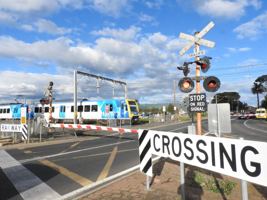 Level crossing with boom gates down at Cherry Street in Werribee.