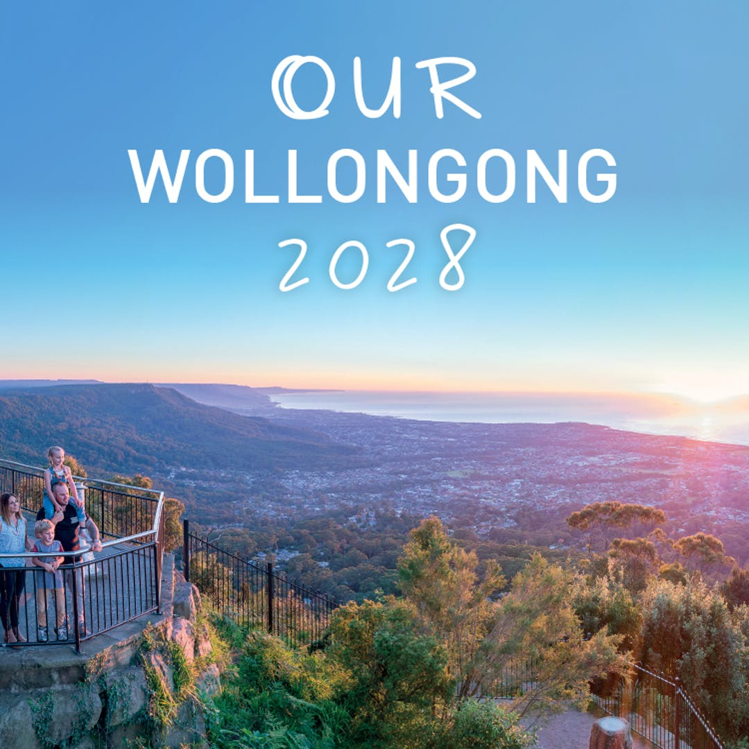 The words Our Wollongong 2028, against a backdrop of people looking out from a lookout on the Illawarra escarpment.