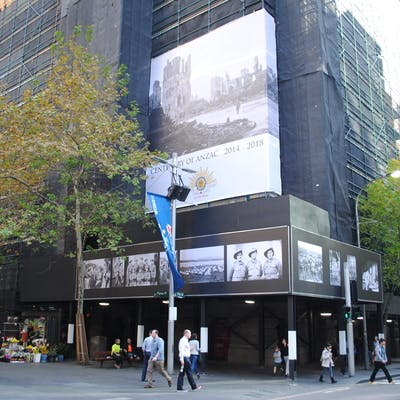 Type B hoarding displaying special event images and scaffolding wrap