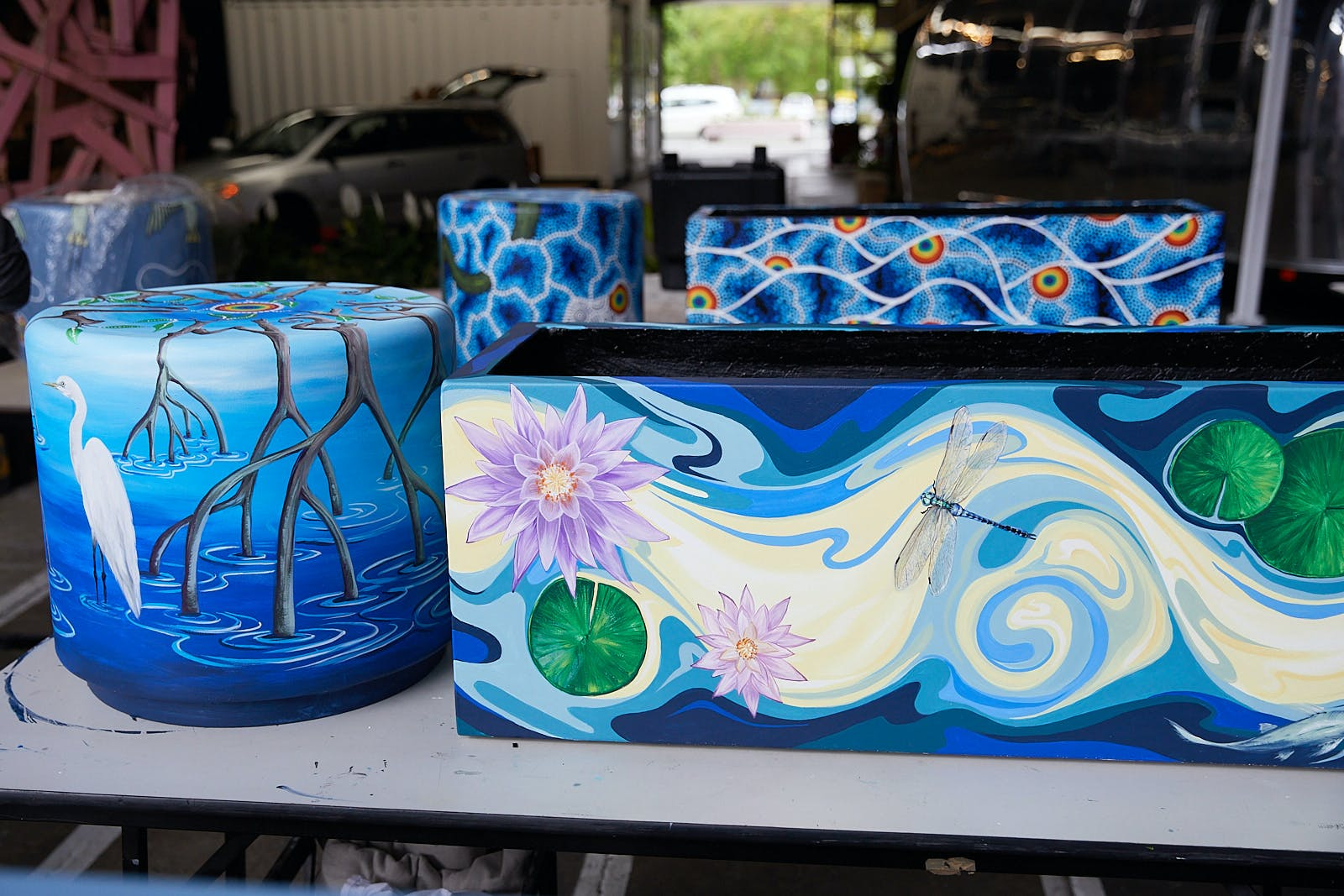Water theme artwork by Mealie Batchelor (front) and  Jason King (back)