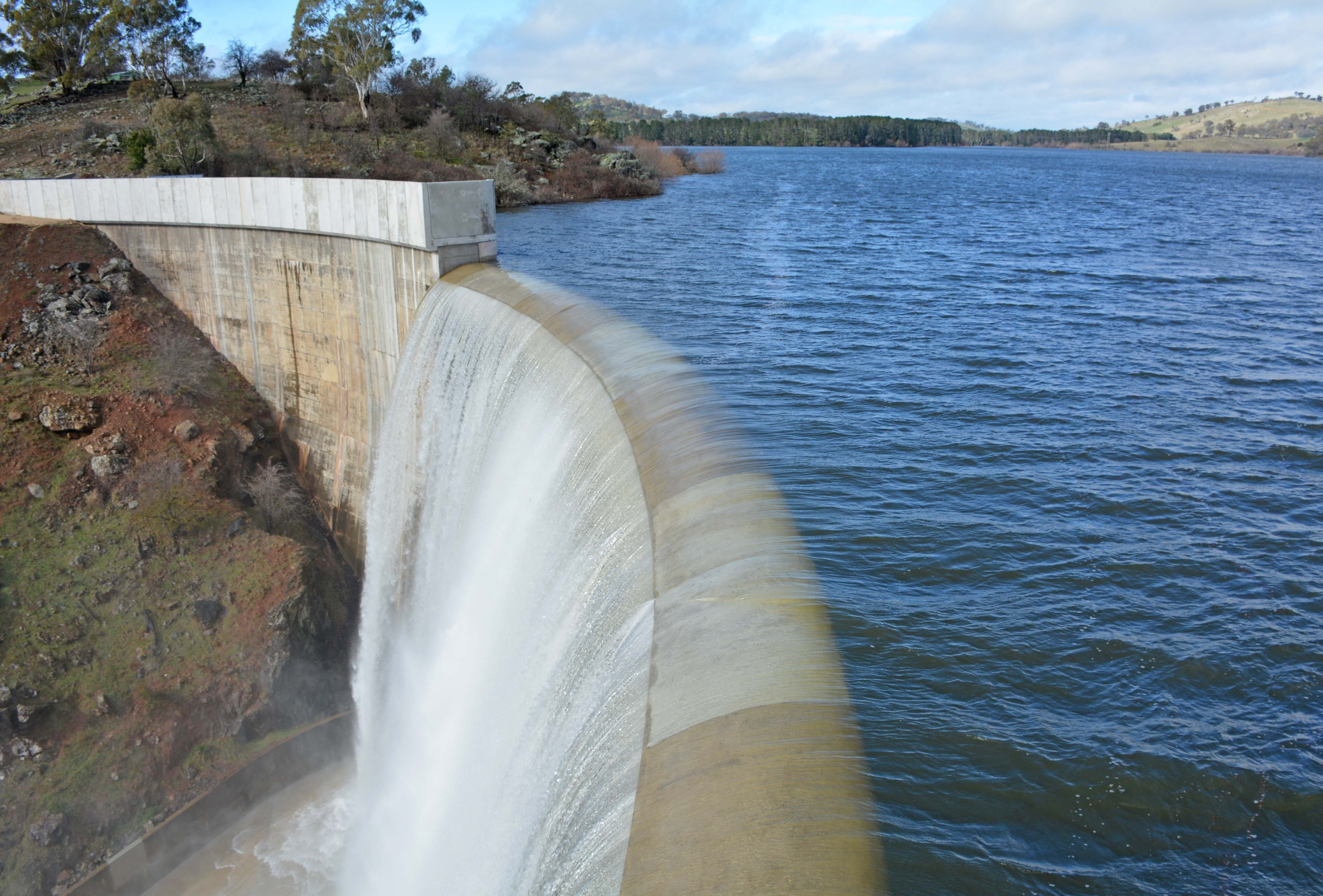 Water flows over the new higher dam wall at Suma Park