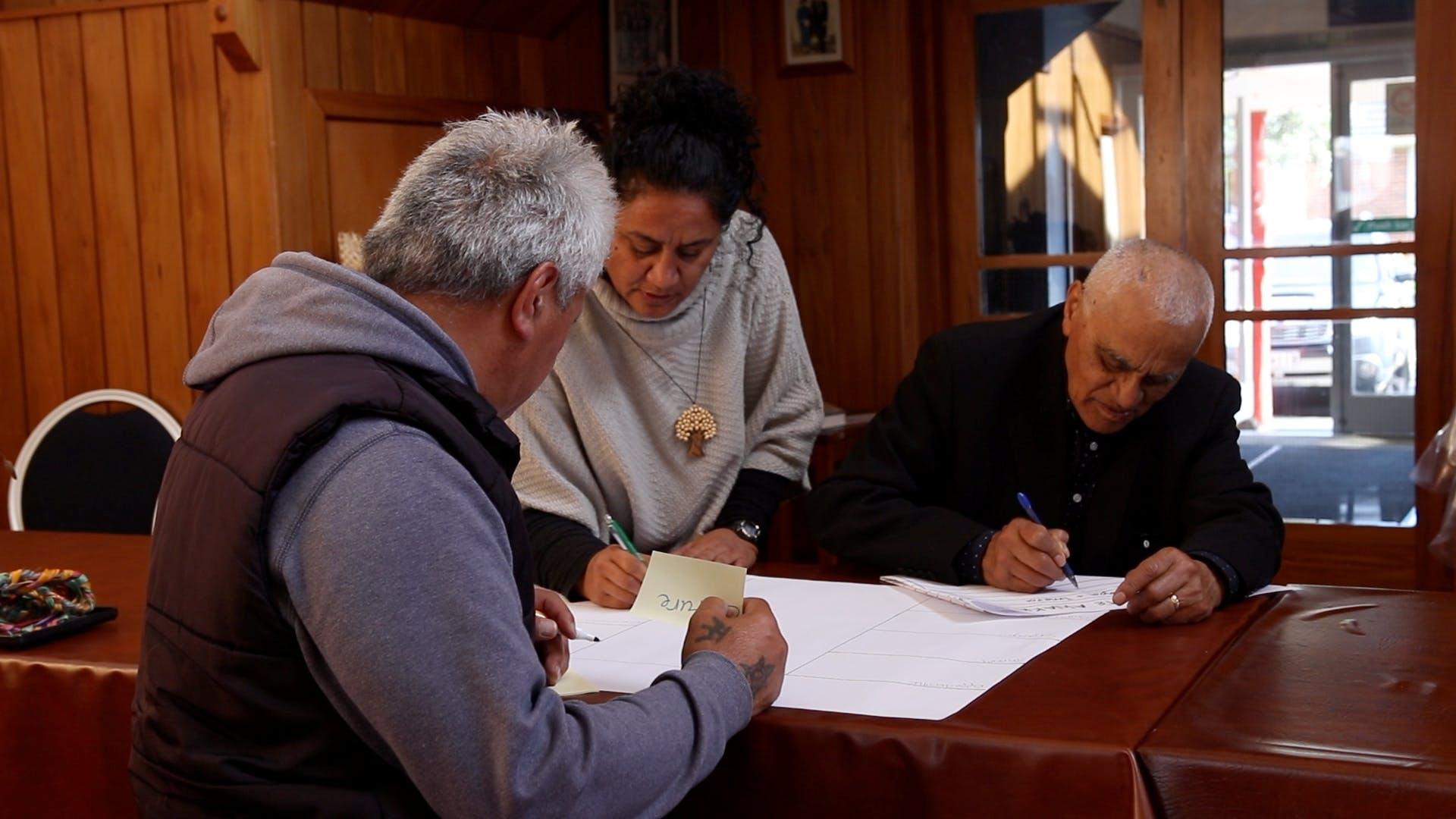 Riri Ellis sharing kōrero with kaumātua