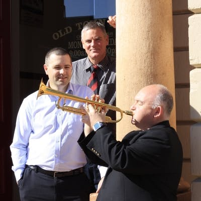 City of Mount Gambier Mayor, Steve Perryman and Chief Executive Officer, Mark McShane with James Morrison at the doors of the Old Town Hall. Photo Credit: The Border Watch