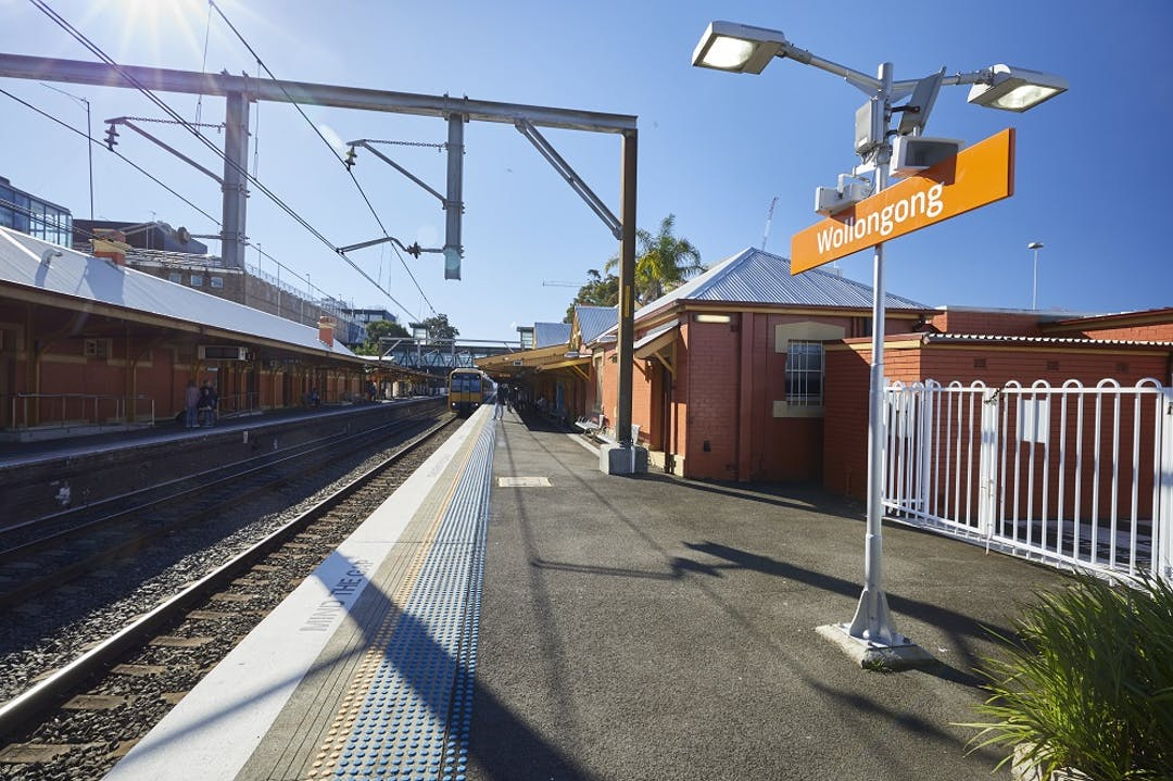 Image of Wollongong Station platform showing a train pulling into the station