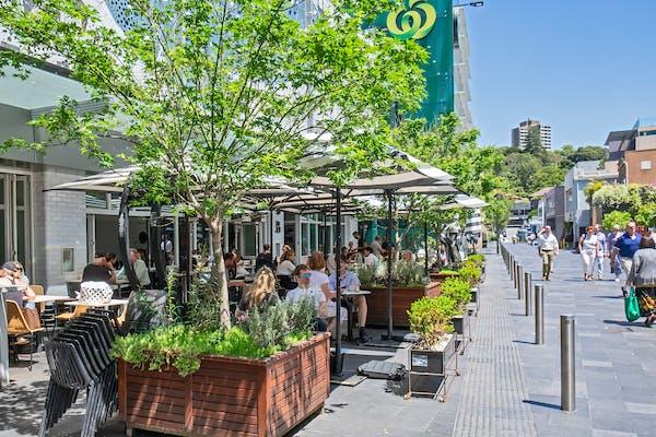 People dining outdoors at Kiaora Place in Double Bay