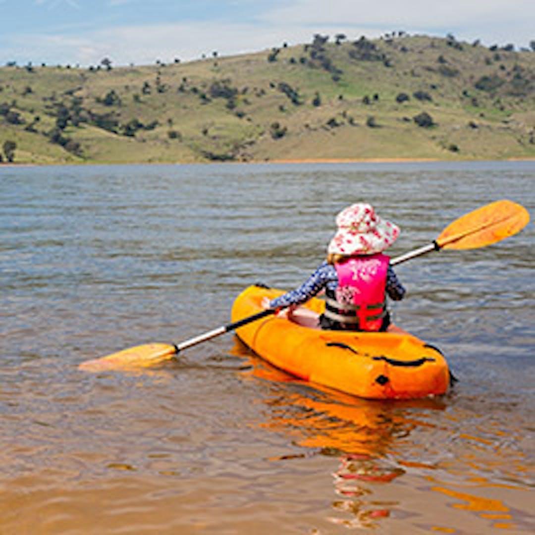 child paddling on NSW dam