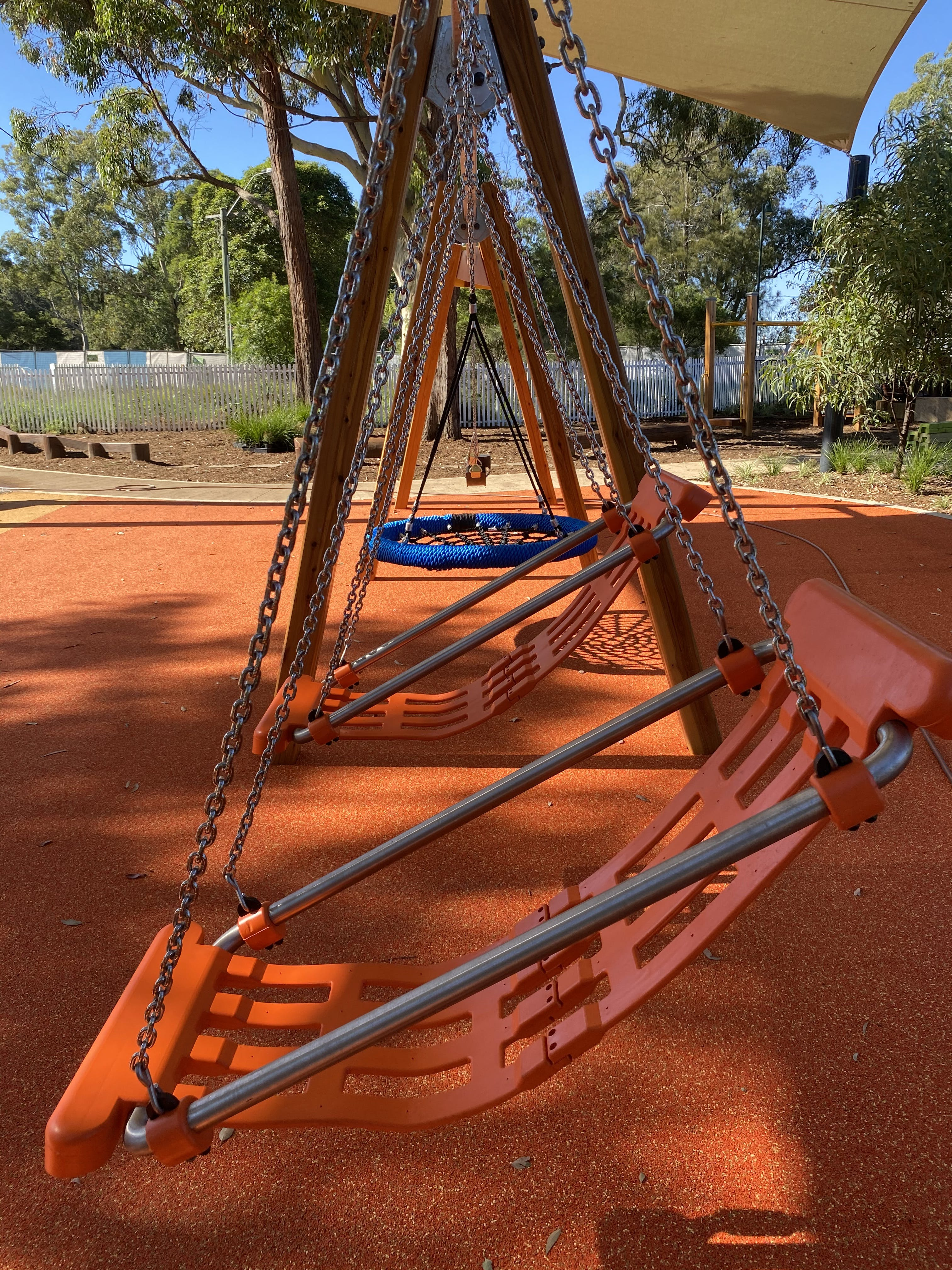 Inclusive swing set under shade sails