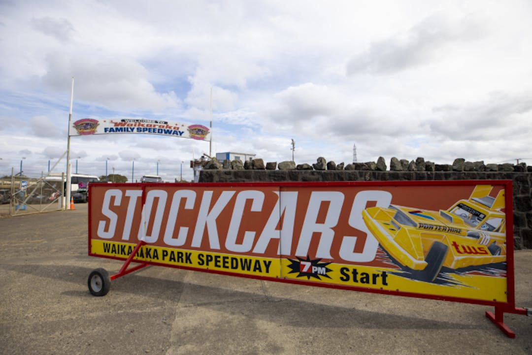 A sign advertises a stockcars event at the Waikaraka Park Family Speedway