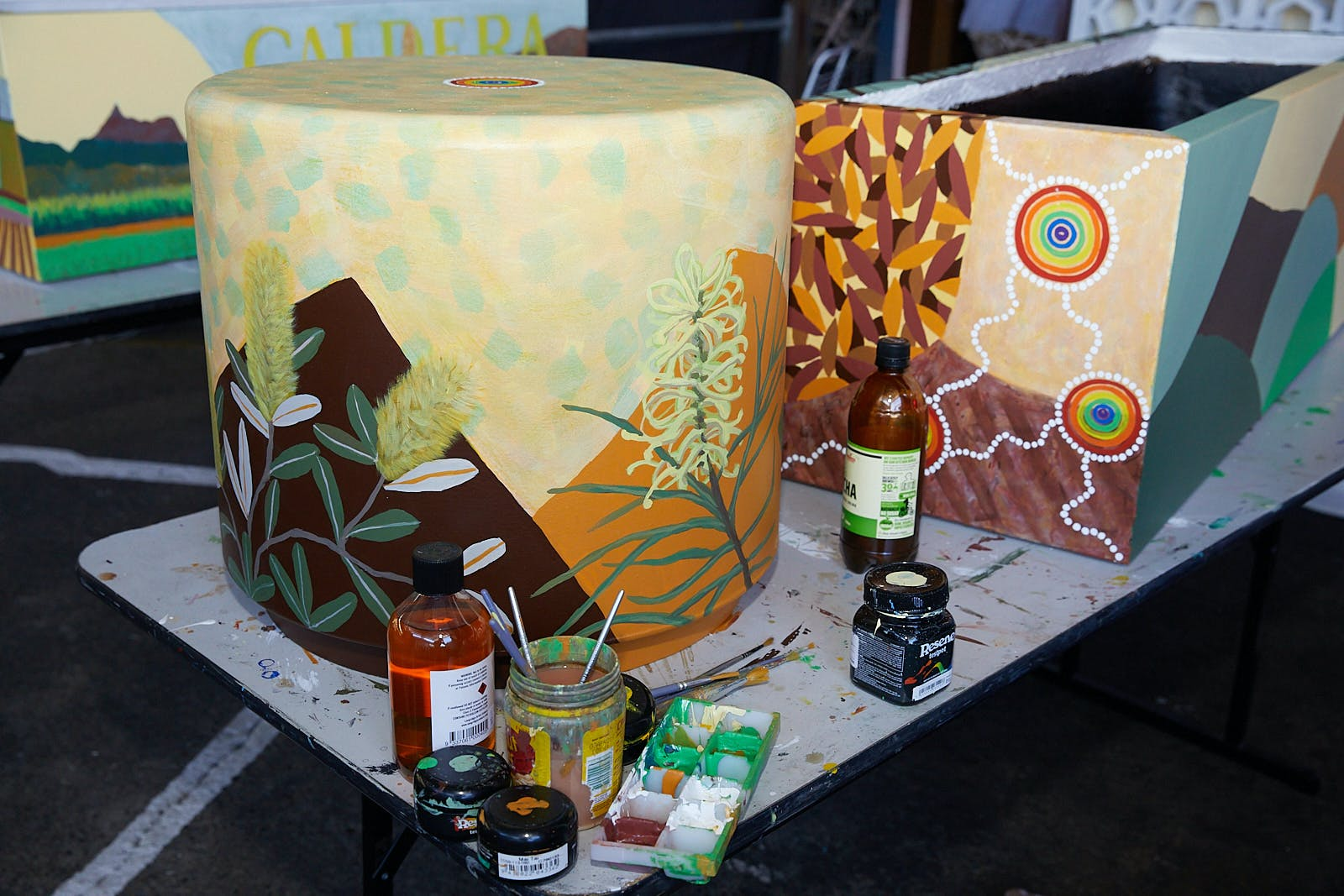 Judy Oakenfull's land themed art seat and planter box
