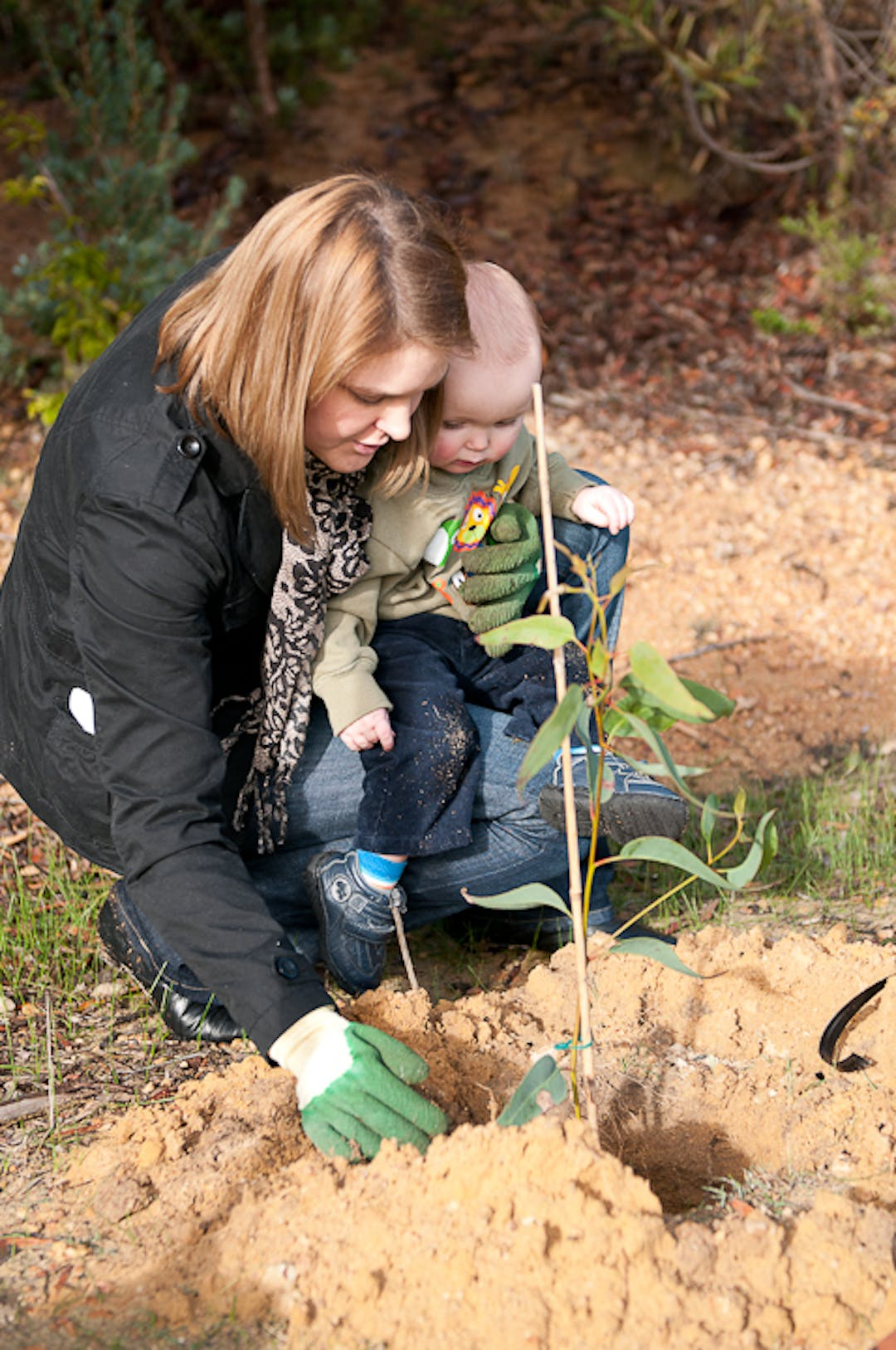 Mother and child planting a commemorative tree