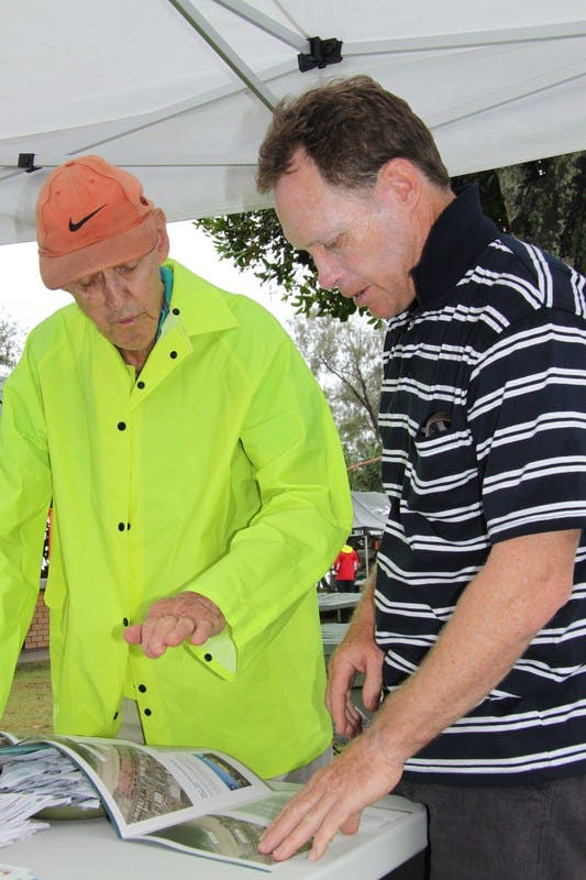 Noel Manthey (left), a Kingscliff resident for more than 30 years, discusses the Central Park concept plans with Council's Senior Design Engineer, Warren Boyd, at the community information stall in Kingscliff