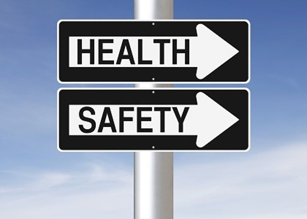 Image of road sign arrows that say Health and Safety