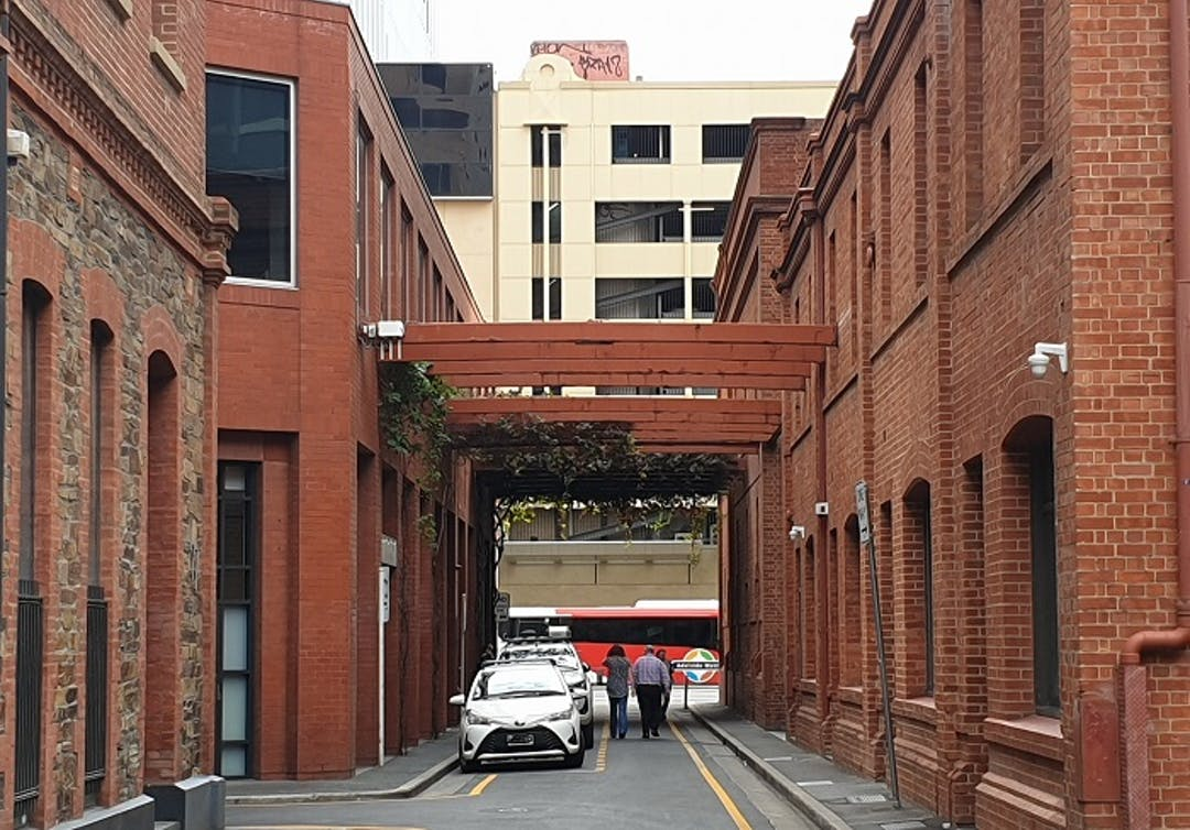 Image of Chesser Street from the section between the corner of French Street and Grenfell Street. In the image you can see parked cars and pedestrians walking along Chesser Street towards Grenfell Street.