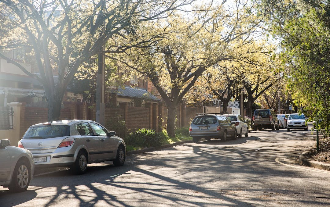 Image of cars parked along a residential street