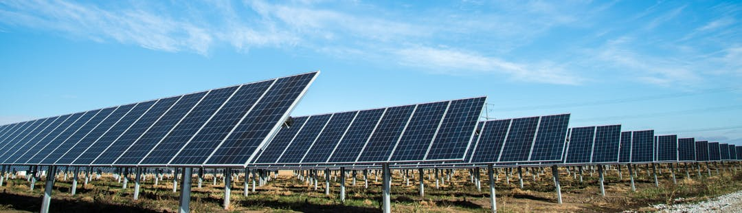 Solar farms reduce reliance on fossil fuels.
