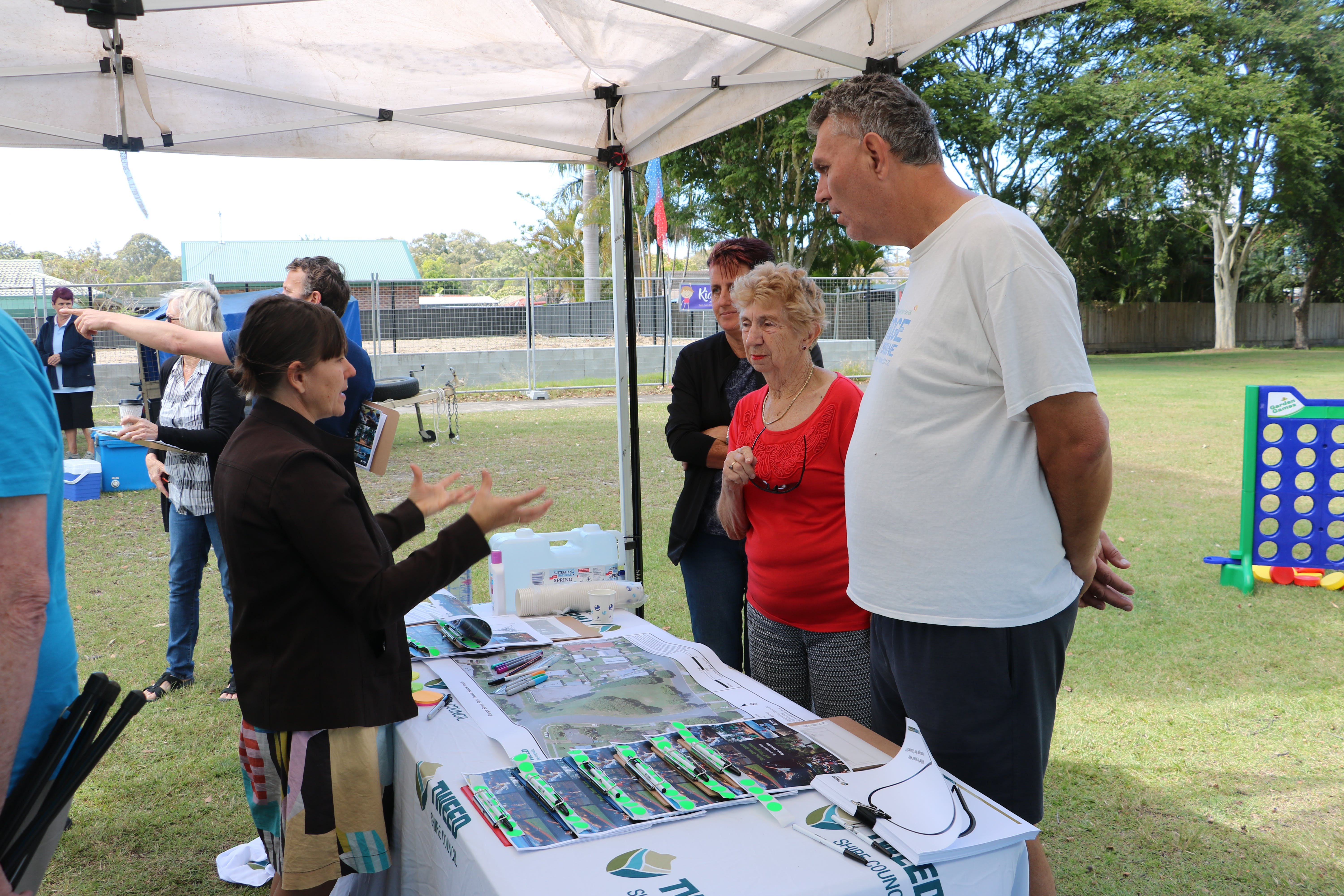 Tweed Shire Council staff talking to locals about the proposed park upgrades.