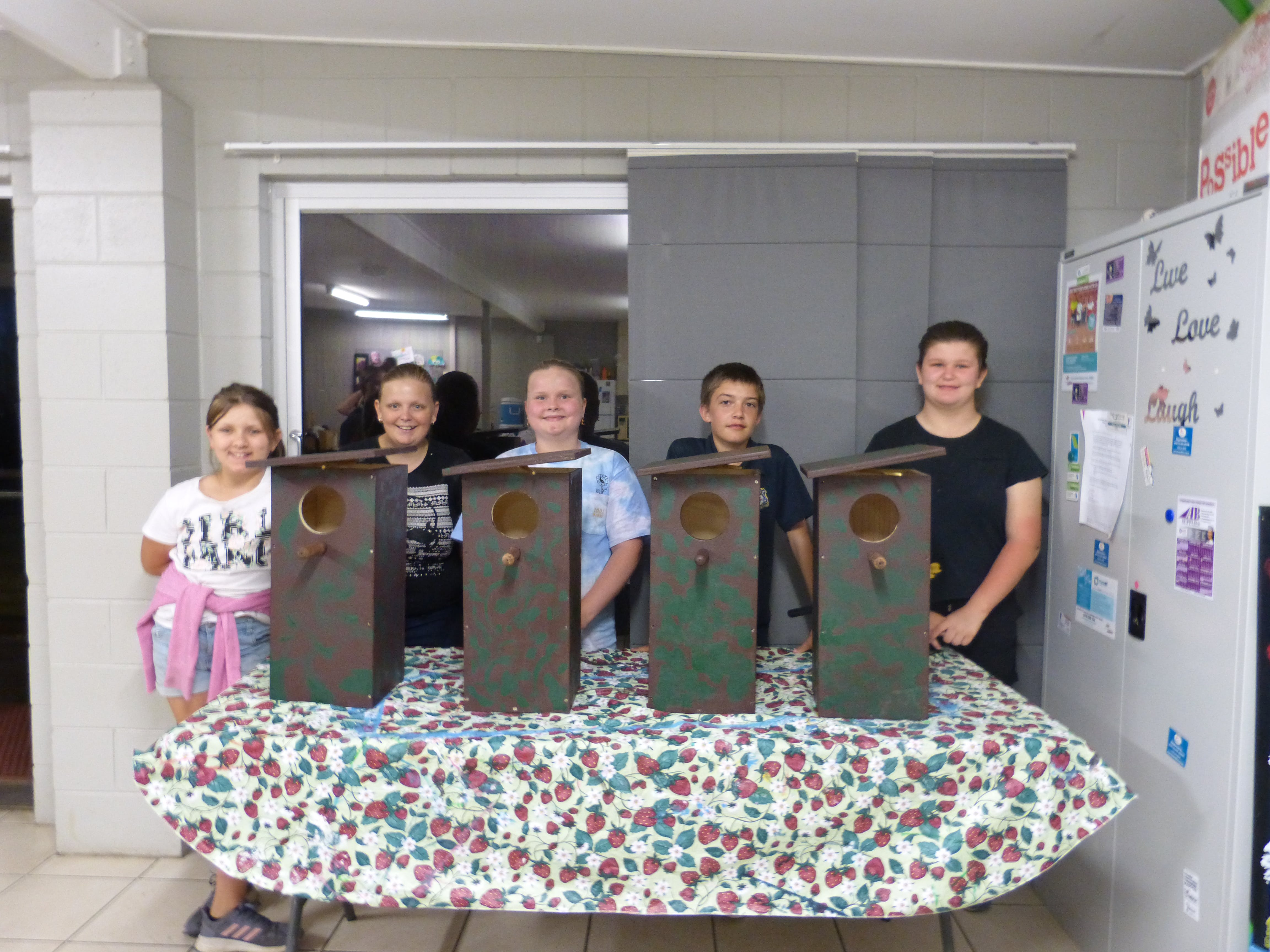 Amelia Peace, Jade Stevens, Zoe Harvey, Justin Shaxson, Jezibell Wilson with the possum boxes they built with assistance from the Moore Park Beach Mens' Shed