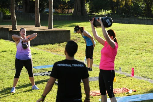 Outdoor group fitness training in city park