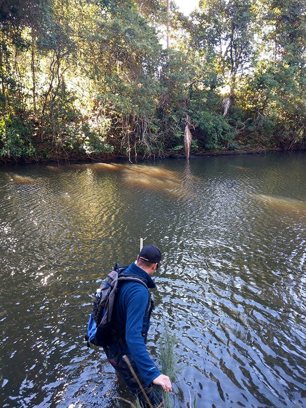 Eco Logical Senior River Scientist Dr Mark Southwell takes a depth reading on the Tweed River in the first environmental flow survey of Doon Doon Creek and the Tweed River down to Bray Park Weir.