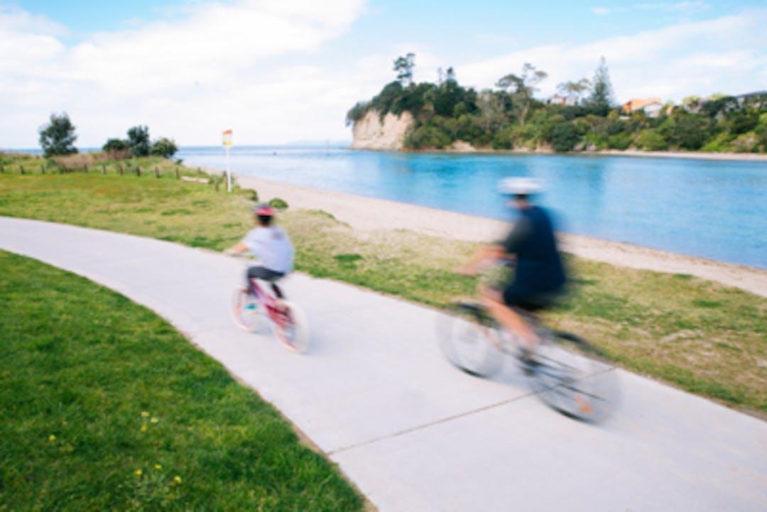 Children cycle the Orewa Estuary path