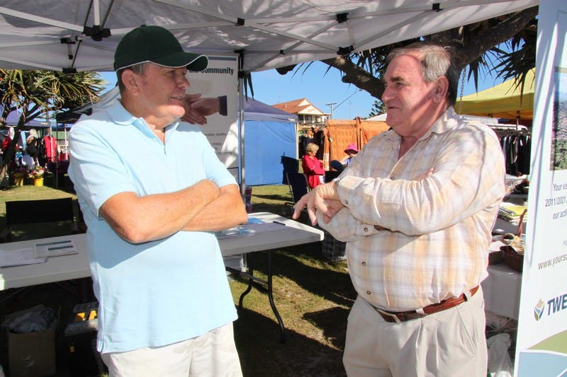 Ron Parks (left) of Kingscliff speaks to Tweed Councillor Warren Polglase at the community information stall at the Kingscliff Markets.