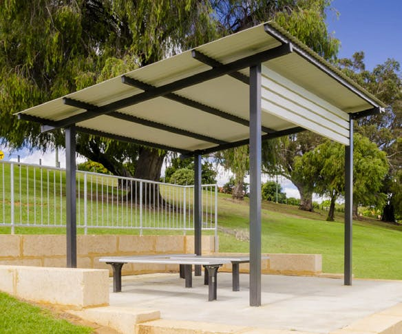 Shade shelter with seating and drinking fountain