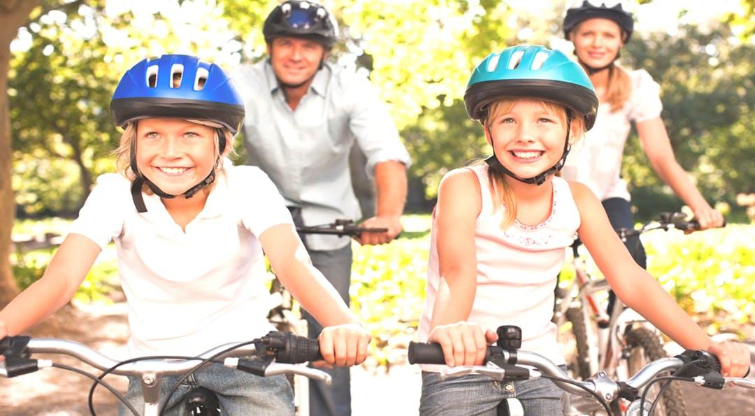 Family on bike image