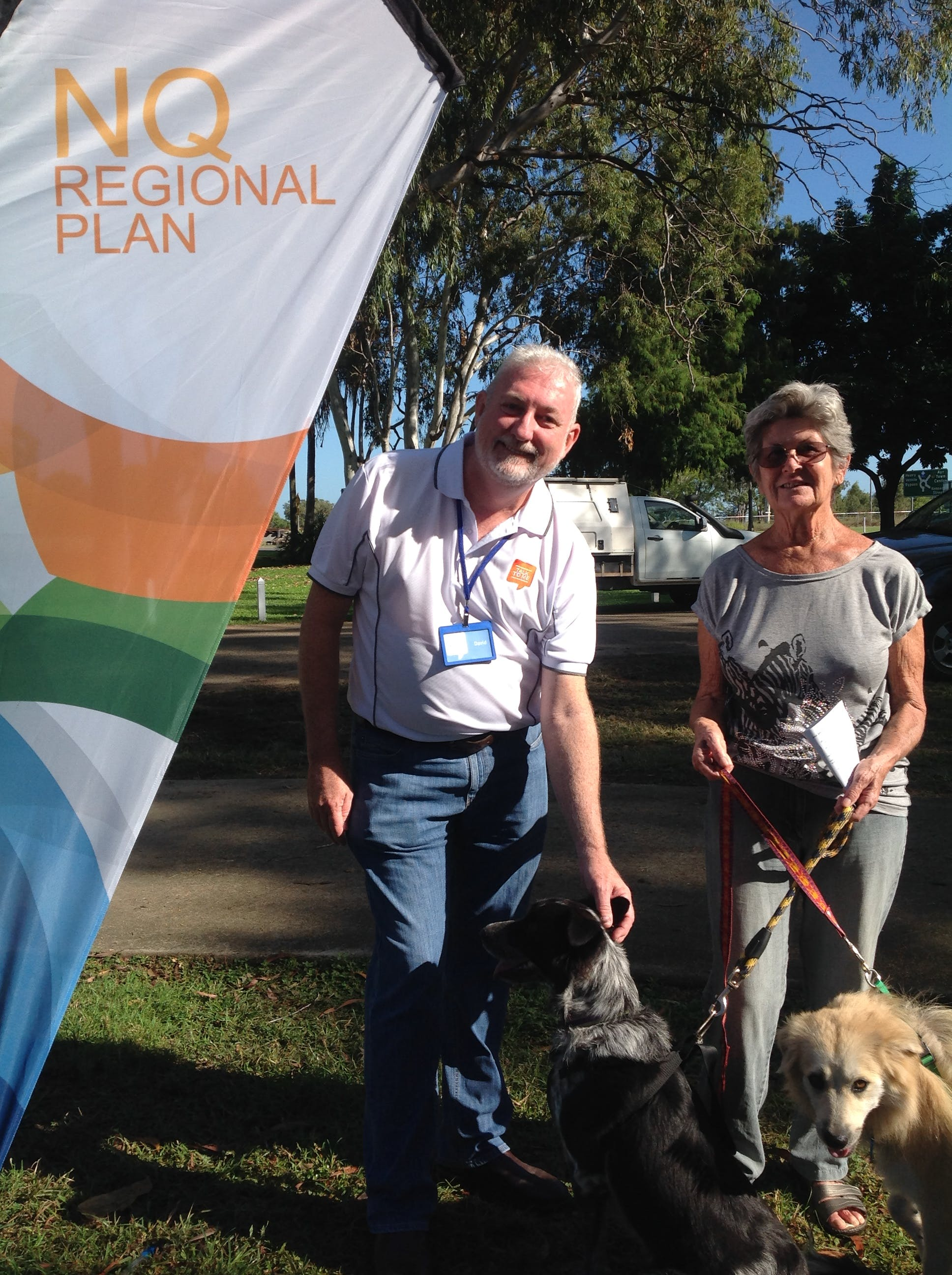 North Queensland Regional Plan engagement team member David with Del and her rescue dogs at the Plantation Park markets on Sunday 21 May.
